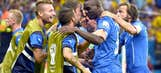 Balotelli helps Italy capture World Cup win over England