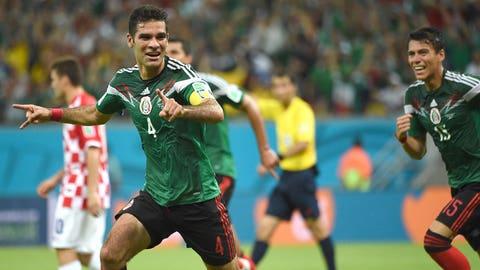 Mexico advances, Miguel Herrera jumps for joy