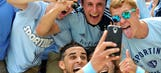 Soccer player scores goal, takes selfie, sees yellow