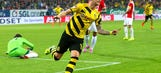 Marco Reus stands out as Dortmund fight off Augsburg to right ship