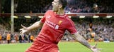 Balotelli scores as Liverpool come back to beat Swansea in League Cup