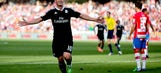 Real Madrid cruise to victory over Granada and take over top spot