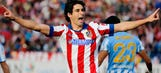 Atletico Madrid beat Malaga to stay in hunt for top spot in Spain