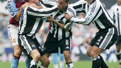 Newcastle teammates Lee Bowyer and Kieron Dyer fight during Premier League match