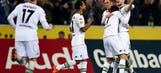 Ten-man Gladbach outlast Darmstadt to go into break in fourth
