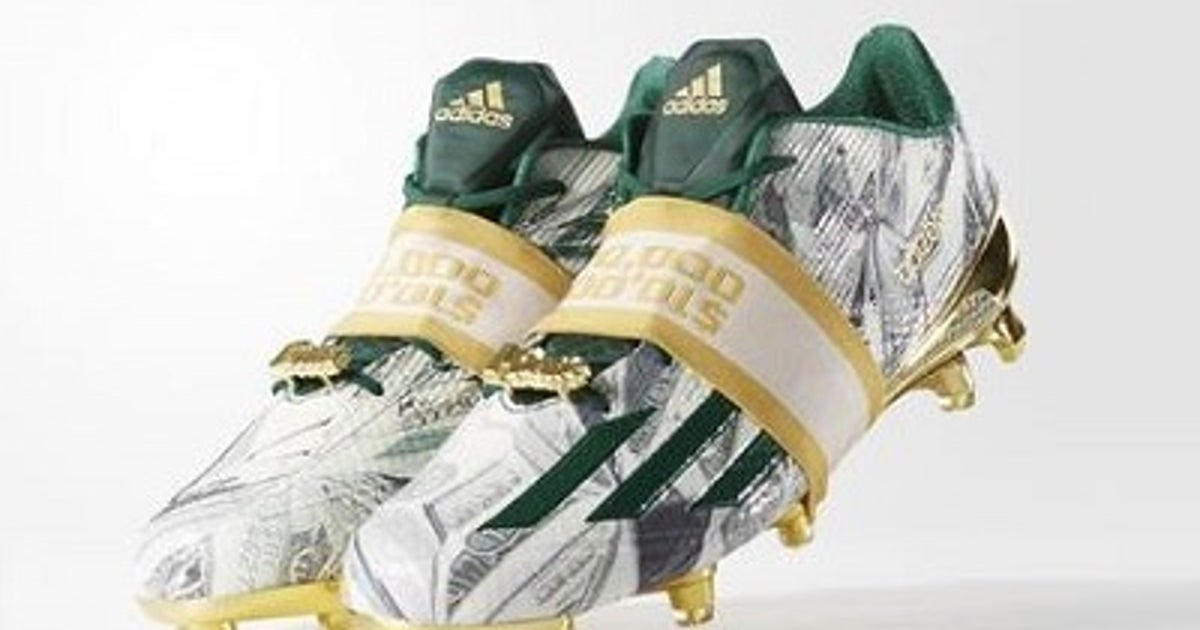 3e8c6a91e47 Snoop Dogg s absurd new  Money Cleats  come wrapped like stacks of 100s
