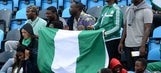 Nigeria fans pack stadium, watch from light posts and scoreboard