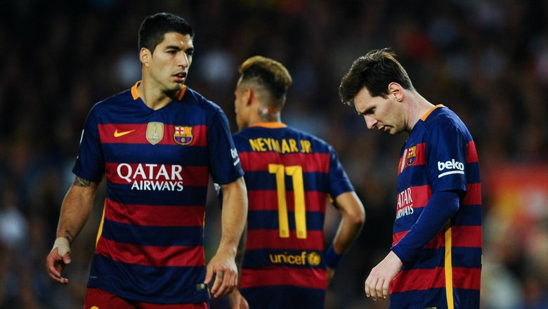 Messi scores number 500 but Barcelona still fall to plucky Valencia