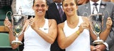 American Sock and Canadian Pospisil, Italy's Errani and Vinci win Wimbledon doubles