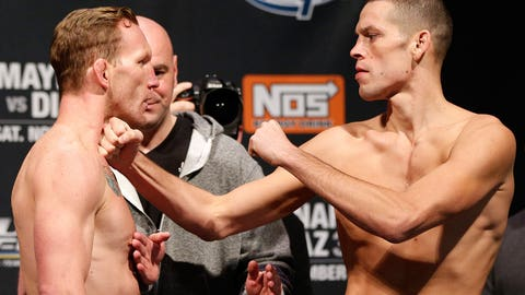 Maynard and Diaz with the rare fist-in-throat faceoff