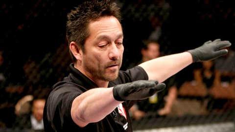 Referee Mario Yamasaki waves off the fight