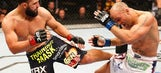 Hendricks wins UFC welterweight title in instant classic over Lawler