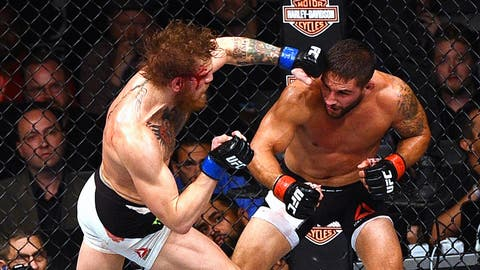 Winning the featherweight title at UFC 189
