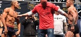 Trash talk, near rumble as Jose Aldo, Conor McGregor separated at UFC 194 weigh-ins