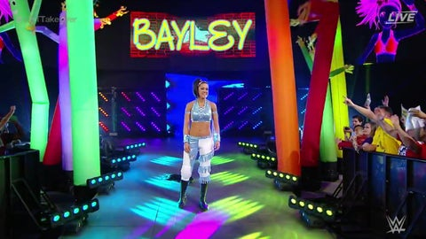 Bayley will replace Eva Marie in the 6-woman tag match and move up to SmackDown