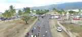 Spectator pulls barrier across road, causes scary cycling accident