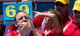 Joey Chestnut eats a record 70 hot dogs to take back his title