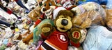 Watch Calgary Hitmen fans throw more than 28,000 teddy bears onto the ice for charity
