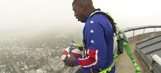 Watch a Harlem Globetrotter hit a 583-foot shot from the top of a tower