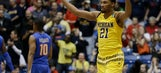 Michigan wins on another late shot, advances to face Notre Dame