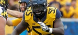 West Virginia loses offensive tackle Yodny Cajuste for the season