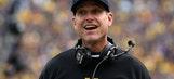 Michigan coach Jim Harbaugh joins the chain crew while recruiting in California