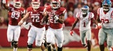 Cornelius' late TD run lifts Arkansas past Ole Miss 34-30