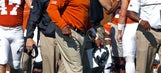 Embattled coach Strong leads Texas in trip to Kansas