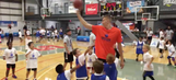 Let's watch Kristaps Porzingis play basketball with kids half his size, on a rim as tall as he is