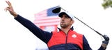 Michael Phelps breaks out his signature arm flap before teeing off at Ryder Cup