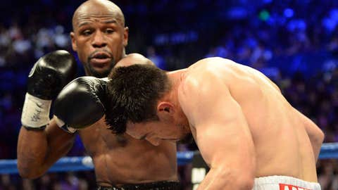 Image: (From left) Floyd Mayweather & Robert Guerrero fight in Las Vegas (© Jayne Kamin-Oncea / USA Today Sports)