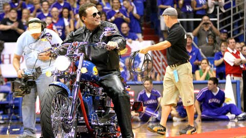 Kansas head coach Bill Self rides out onto James Naismith court on a custom-made motorcycle