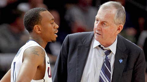 Connecticut Huskies head coach Jim Calhoun talks with guard Ryan Boatright (11)