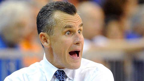 Florida coach Billy Donovan, left, talks with referee Terry Moore