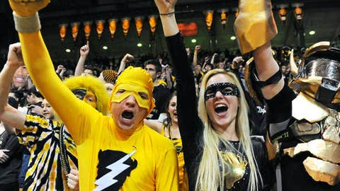 Colorado Buffaloes fans cheer on before the start of overtime against the Arizona State Sun Devilsat