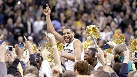 Wake Forest's C.J. Harris (center) celebrates with fans .
