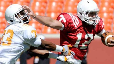 Tennessee defensive back LaDarrell McNeil tries to stop Nathan Peterman (12) as he carries the ball during an NCAA college football spring scrimmage