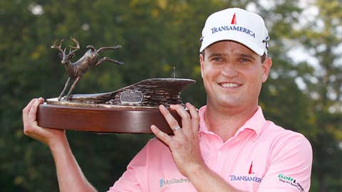 Zach Johnson holds the trophy after winning the John Deere Classic