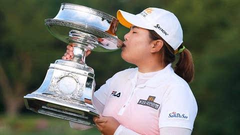 Inbee Park of South Korea kisses the trophy after winning the Wegmans LPGA Championship