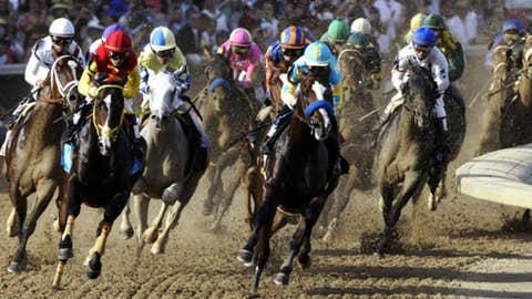 Mike Smith aboard Bodemeister (6) leads the field