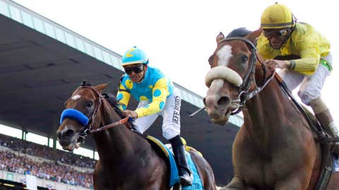 Jockey John Velazquez rides Union Rags, right, to victory over Paynter, with jockey Mike Smith