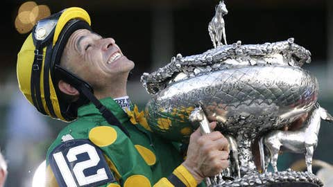 Jockey Mike Smith holds the Belmont Stakes trophy