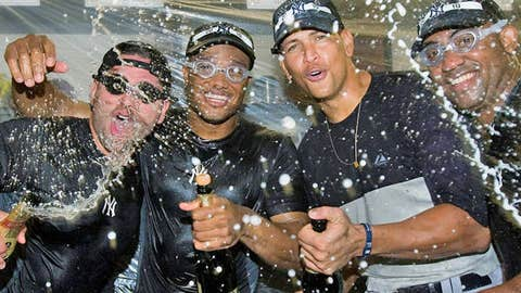 New York Yankees celebrate playoff berth (Nathan Denette/Associated Press)