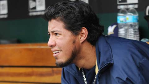 Milwaukee Brewers' starting pitcher Yovani Gallardo watches