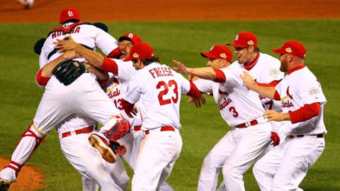 Yadier Molina #4, Gerald Laird #13 and David Freese #23 (Photo by Dilip Vishwanat/Getty Images)