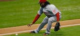 Cueto, Reds earn defensive honors