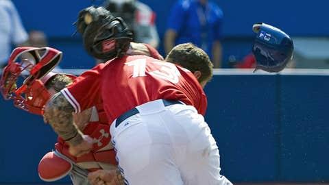 Brett Lawrie slams into Los Angeles Angels catcher John Hester