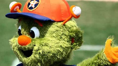 Houston Astros mascot Orbit waves to fans