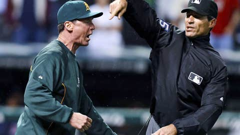 Umpire Angel Hernandez, right, ejects Oakland Athletics manager Bob Melvin for arguing a call in the ninth inning of a baseball game