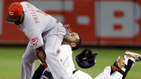 Image: Jonathan Villar slides into Brandon Phillips (Pat Sullivan, AP)